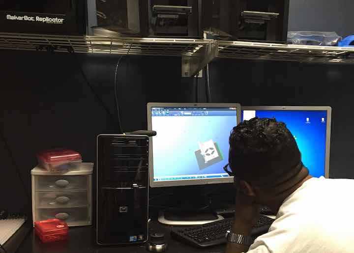 Industrial engineer Rashad Glover prepares the STL files for the 3D printer.