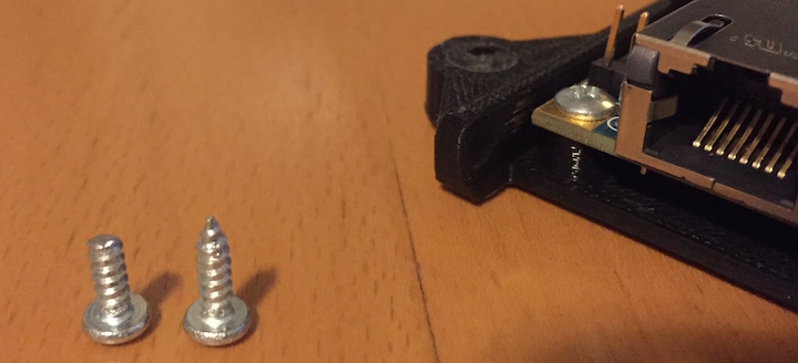 Sheet metal screws (#4). Left screw was shortened with a Dremel.